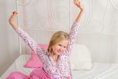 Young girl wakes up in the morning in the bedroom Stock Photos
