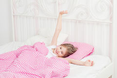 Young girl wakes up Royalty Free Stock Images