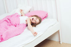 Young girl wakes up Royalty Free Stock Photography