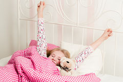 Young girl wakes up in the morning. In the bedroom Stock Photos