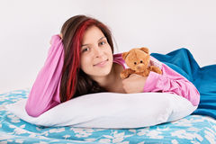 Young girl waking with her teddy bear Royalty Free Stock Photography