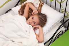 Young girl waking up with a smile Royalty Free Stock Images