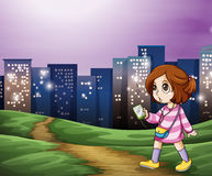A young girl walking across the tall buildings Royalty Free Stock Image