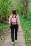 Young girl walking along a path in the forest royalty free stock photos