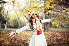 Young girl walking in autumn park Stock Photos