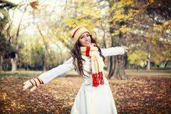 Young girl walking in autumn park Stock Photos