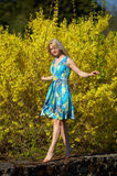 Young girl walking barefoot Stock Photo