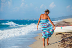 Young girl walking on the beach Royalty Free Stock Photography