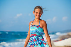Young girl walking on the beach Stock Photo