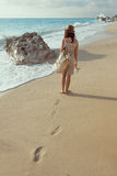 Young girl walking on the beach Royalty Free Stock Photo