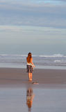 Young girl walking on beach. Stock Photos
