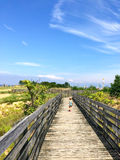 Young girl walking down boardwalk. In summertime Stock Images