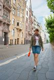 Young girl walking down the street Stock Photos