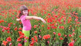 Young girl walking into field of poppies. A young girl walking into field of poppies Royalty Free Stock Image