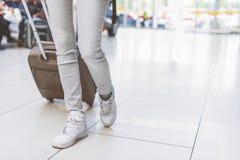 Young girl walking with luggage Stock Photo