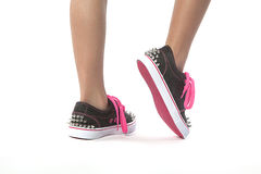 Young girl walking with new shoes with studs. Young girl walking with new shoes with stud on a white background Stock Photos