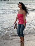 Young girl walking in the ocean Stock Image