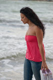 Young girl walking in the ocean Stock Photos