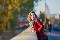 Young girl walking in Paris on a sunny fall day Royalty Free Stock Images