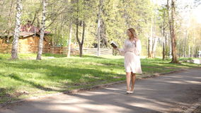 Young girl walking in the park stock footage