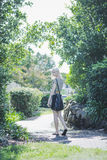 Young girl walking through park Royalty Free Stock Photo