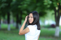 Young girl walking in the park are walking gait Stock Photos