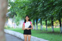 Young girl walking in the park are walking gait Royalty Free Stock Image