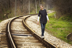 Young girl walking on rails Royalty Free Stock Image