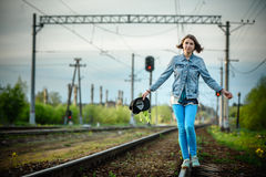 Young girl walking on the railway. Top views Royalty Free Stock Image