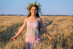 Young girl walking on ripe wheat field at sunlight Royalty Free Stock Image