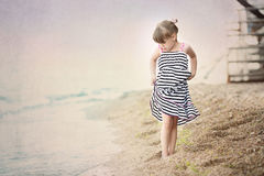 Young girl walking on the sea coast Royalty Free Stock Photos