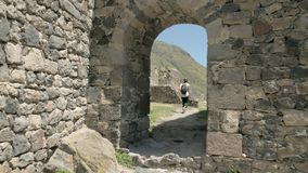 Young girl walking and see Khertvisi fortress - Georgia.  stock footage