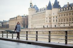 Young girl walking by the Seine in Paris Royalty Free Stock Photos