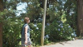 Young girl walking in tropical botanical garden. Batumi, Georgia.  stock video footage