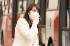 Young girl walking wearing a mask in the city Stock Images