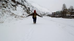 Young girl walking in winter snow Stock Images