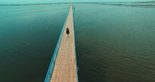 Young girl walking on wooden bridge. Tourism and travel. stock footage