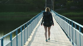 Young girl walking on wooden pier stock video footage
