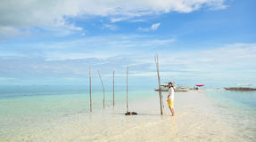 Young girl walks on long narrow beach Royalty Free Stock Photos