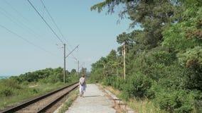 Young girl walks on the railway. Georgia.  stock video