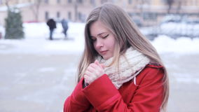 Young girl warm her hands stock footage