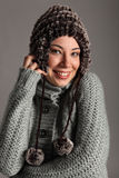Young girl warm for winter in wool sweater and hat Stock Images