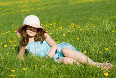 A young girl was lying in the meadow Stock Image