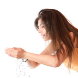 Young girl washes with clean water Stock Photography