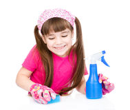 Young girl washes table. isolated on white background Stock Photography