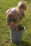 Young girl washing in bucket Royalty Free Stock Images