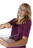 Young girl washing dish's holding bowl and sponge Royalty Free Stock Photo