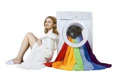 Young girl and washing machine with colorful things to wa. Beauty young girl and washing machine with colorful things to wash, Isolated Royalty Free Stock Photo