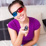 Young girl watching 3d television Stock Photography