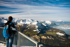 Girl watching from the Frontalpstock peak to the Lake Lucerne Royalty Free Stock Photos